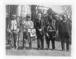 President Calvin Coolidge with four Osage Tribal members after Coolidge signed the bill granting Native Americans full citizenship, 1924