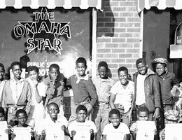 "Young men in front of ""The Omaha Star"""