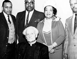 Father John Markoe, seated, and Mildred Brown, second from right, with other adult members of the DePorres Club